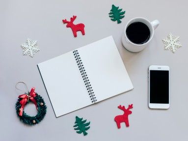 Creative flat lay of christmas craft and blank notebook mock up