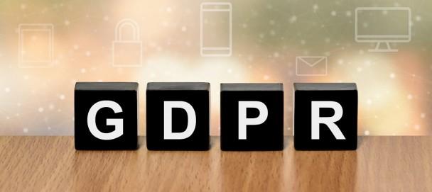 GDPR on black block with digital icon