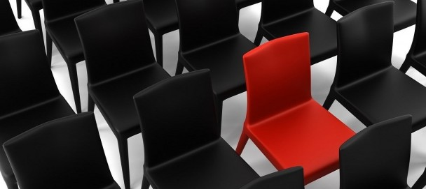 red chair among black chairs