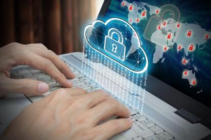 Businessman use Laptop with interface of padlock and cloud compu